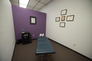 chiropractic room with electric muscle stimulation machine