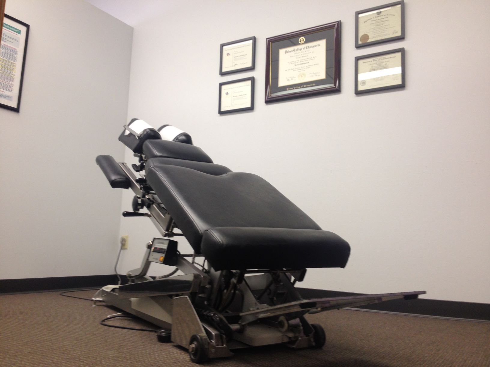 chiropractic room with hylo table
