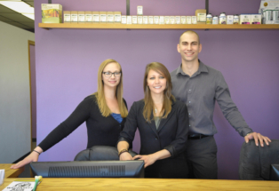 Dr. Nick and Dr. Sara, chiropractors at Hellenbrand Rabideaux Chiropractic with Candice the massage therapist
